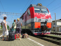 Passengers on the platform of the station Lazarevskoye Sochii expected arrival of the train Royalty Free Stock Image