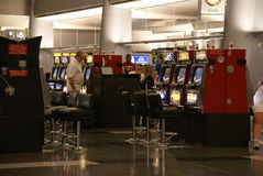 Passengers play video slot machines Stock Photography
