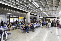 Passengers prepare to check-in at Guarulhos Airport in Sao Paulo, Brazil. Stock Image