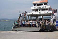 Passengers prepare to disembark. CANAKKALE, TURKEY - MAY 23, 2014 - Passengers prepare to disembark the ferry after crossing  the Dardanelles  from Gallipoli Stock Images