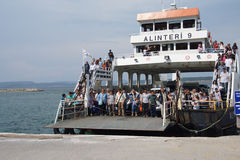 Passengers prepare to disembark. CANAKKALE, TURKEY - MAY 23, 2014 - Passengers prepare to disembark the ferry after crossing  the Dardanelles  from Gallipoli Royalty Free Stock Photos