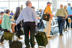 Passengers queued in line for boarding at departure gate Royalty Free Stock Image