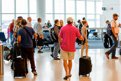 Passengers queued in line for boarding at departure gate Royalty Free Stock Photo