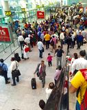 Passengers queuing at the boarding gate. At the domestic airport in New Delhi India Royalty Free Stock Image