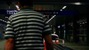 Passengers at railway station. Rho fiera Milano stock footage
