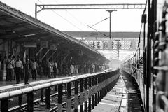 Passengers at the railway station. Train and the other side of station. Kerala, India, South Asia Royalty Free Stock Photos