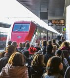 Passengers ready to board the Frecciarossa high speed train at the Venice St. Lucia railway station. Venice, Italy - March 26th, 2018: Passengers ready to board Stock Photos