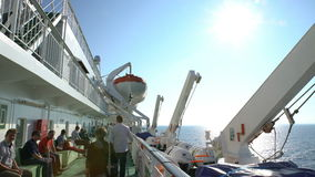 Passengers relax on the deck of a large sea ferry `Viking Line` stock video footage