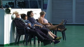 Passengers rest on the upper deck of a large sea ferry. BALTIC SEA - MAY 31, 2016: Passengers rest on the upper deck of a large sea ferry Viking Line during the stock video