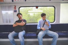 Passengers. Resting while traveling Stock Photo