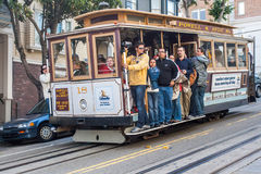 Passengers ride in a cable car in San Francisco. Royalty Free Stock Photos