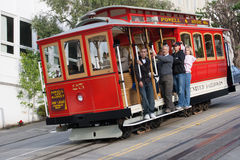 Passengers ride in a cable car in San Francisco. Royalty Free Stock Photography