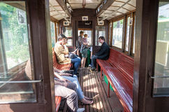 Passengers ride in an old vintage tram Sanok SW-1 in the garage at the depot in Lviv Royalty Free Stock Photos