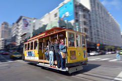 Passengers riding on cable car in San Francisco, CA Royalty Free Stock Images