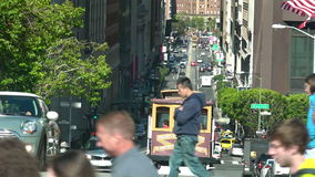 Passengers riding on cable car in San Francisco, CA. SAN FRANCISCO - MAY 17 2015:Passengers riding on cable car in San Francisco, CA.US Department of stock footage