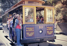 Passengers riding cable car in San Francisco Stock Photo