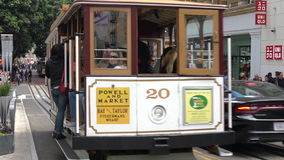 Passengers riding on cable car in San Francisco, California. SAN FRANCISCO - MAY 17 2015:Passengers riding on cable car in San Francisco, CA.US Department of stock video footage