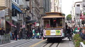 Passengers riding on Powell-Hyde line cable car in San Francisco California stock video footage
