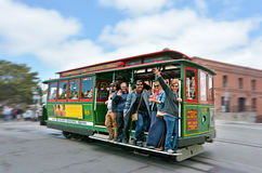 Passengers riding on Powell-Hyde line cable car in San Francisco Royalty Free Stock Photo