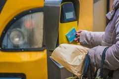 Passengers rush to the train, validate tickets, fare, public transport. Stock Photography