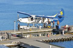 Passengers and Saltspring Air on Canada`s West Coast. Passengers line up to board a Saltspring Air commercial passenger plane in Vancouver harbor on September 11 Stock Photos