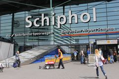 Passengers at the dynamic main entrance of Amsterdam Schiphol Airport,Netherlands Royalty Free Stock Photo