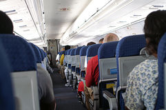 Passengers Seated  on Airplane Royalty Free Stock Photo