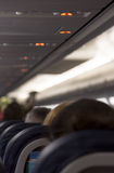 Passengers seating on the plane ready for departure Royalty Free Stock Image