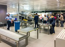 Passengers at security check area in the Milan Malpensa International Airport. Ferno, Milan, Italy - May 5, 2018: Passengers at security check area in the Milan Stock Photo