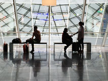 Passengers seen in silhouette waiting in Frankfurt Airport Royalty Free Stock Images