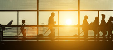 Passengers silhouettes at the airport Stock Images