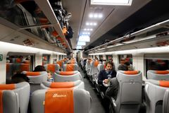 Passengers sit in the high speed trenitalia train Stock Photos