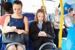 Passengers Sitting On Bus Sending Text Messages Royalty Free Stock Photos