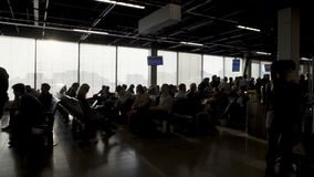Passengers sitting at departure lounge and waiting for boarding, terminal. Stock footage stock video