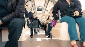 Passengers sitting in tram at day time. Eskisehir, Turkey - April 03, 2017: Interior of a tramway in motion, with people and sunlight stock video footage