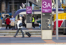 Passengers in the Southern Cross Train Station's Stock Photography