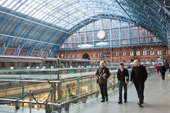 Passengers in St Pancras International station in London. Passengers walk with their trolleys in St Pancras International station in London on April 18, 2013 Royalty Free Stock Photo