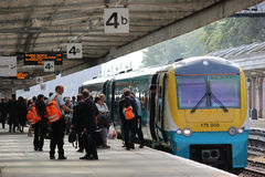 Passengers and staff on platform with dmu train Stock Photos