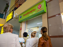 Passengers stand in line at the airline ticket counter S7 Airlines at the airport in Simferopol, Crimea Stock Images