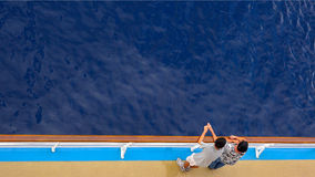 Passengers Standing on Deck of Cruise Ship Off The Coast of Hawa Stock Image