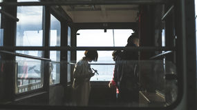 Passengers standing by train windows Royalty Free Stock Photos