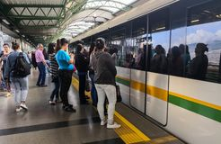 Passengers on a station platform of the Medellin Metro Colombia royalty free stock image