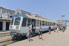 Passengers stepping off train in Ajaccio, Corsica Stock Photo