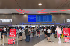 Passengers strolling between ticketing counters at Don Mueang In Royalty Free Stock Images