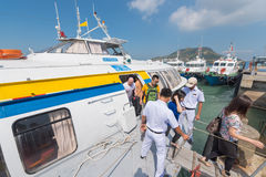 Passengers take off hydrofoil from Saigon in Vungtau Stock Photo