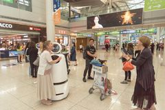 Passengers taking photo with AIRSTAR Passenger Aiding Robot at Incheon airport in South Korea
