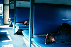 Passengers taking rest in Indian rail Stock Images