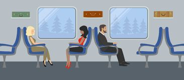 Passengers in the train car. Young women and a man are sitting in blue armchairs and looking out the window. There are also suitcases on the shelves in the Royalty Free Stock Image