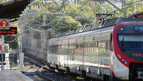 Passengers train leaving of station. A sunny day stock footage