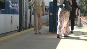 Passengers at train station. A view or scene of Transportion stock video footage